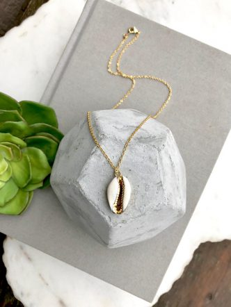 Puka shell necklace with gold