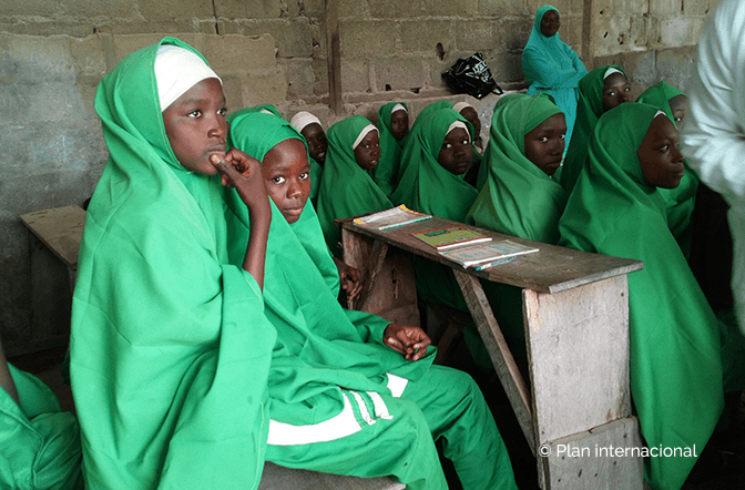 Plan International - Girls sitting in school